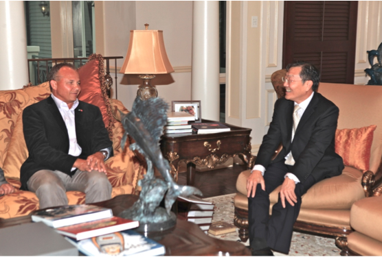 Saying Farewell, Looking Ahead – Leading real estate broker Mario Carey, left, founder of MCR, hosts Chinese Ambassador Hu Shan to a farewell luncheon. The ambassador left The Bahamas last week after a very active two-year posting.